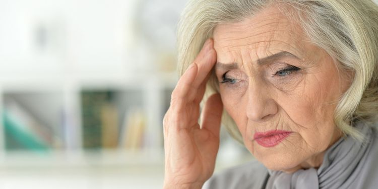 Photo of an old lady with headache