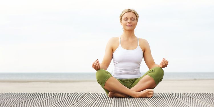 Photo of calm woman meditation outdoors