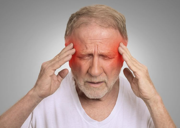 Photo of an Old Man with Headache