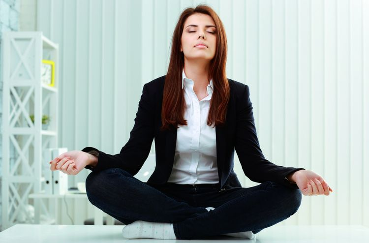 Photoof a business Woman Meditating
