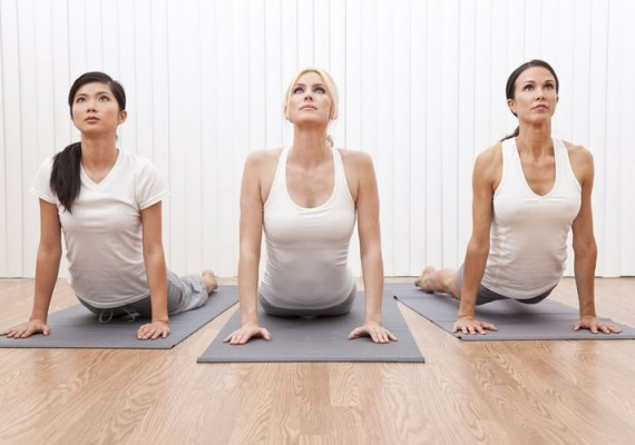 young-women-stretching-in-a-yoga-position-featured