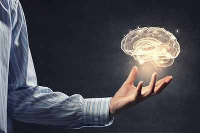 Businessman Holding Digital Image of Brain