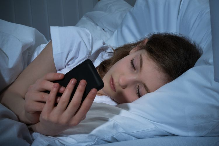 Photo of a Girl Textin On Mobile Phone