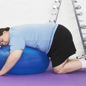 Overweight Man Sleeping On An Excercise Ball