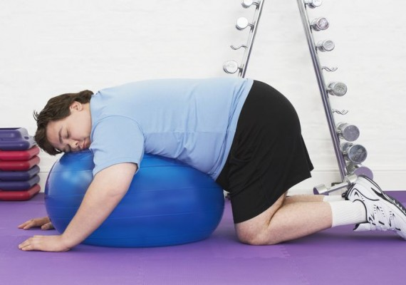 overweight-man-sleeping-on-exercise-ball