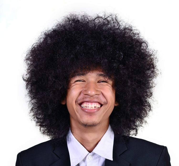 Photo of a man Smiling Huge Hair