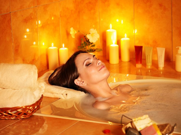 Photo of a Bubble Bath with Candle and Coconut Oil