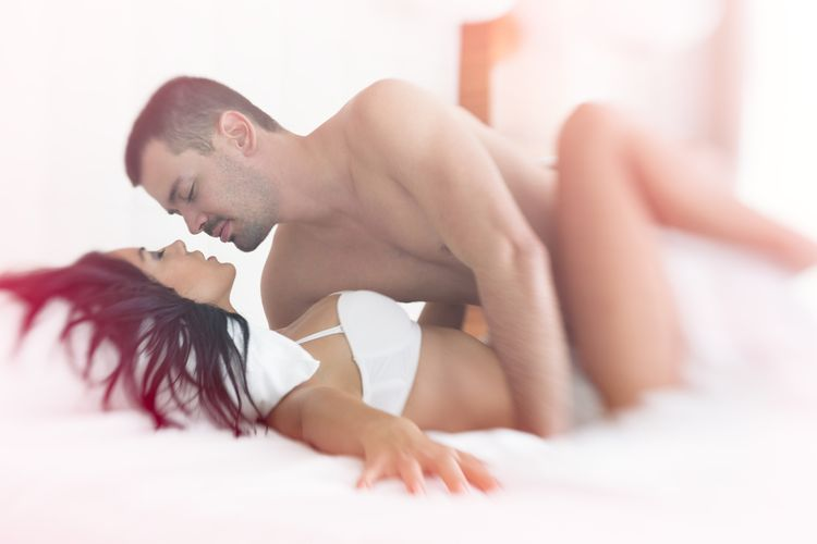 Photo of a Couple Having Sex In Bed