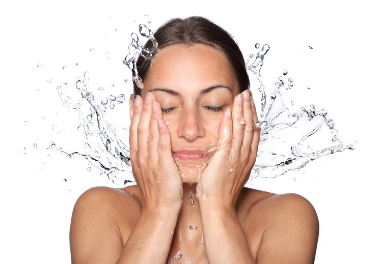 Phot of a girl washing Face With Water Drops