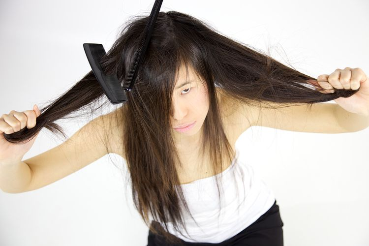 Photo of a girl Having Trouble With Long Hair