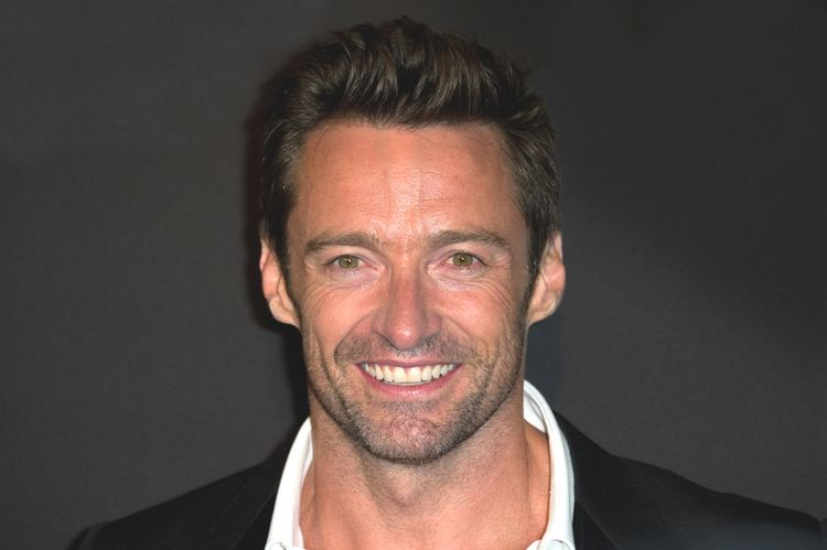 Close up photo of Hugh Jackman smiling