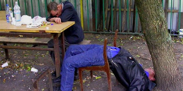 Photo of two drunk men sleeping outdoors