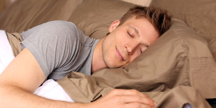 Photo of a happy man with smile sleeping