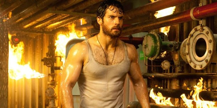 Photo of Henry Cavill in Superman looking shredded