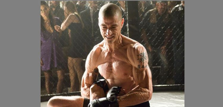 Photo of Matthew Fox In Alex Cross looking extremely shredded