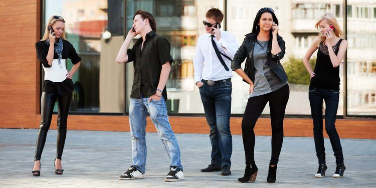 Photo of a group of young people calling on the mobile phones