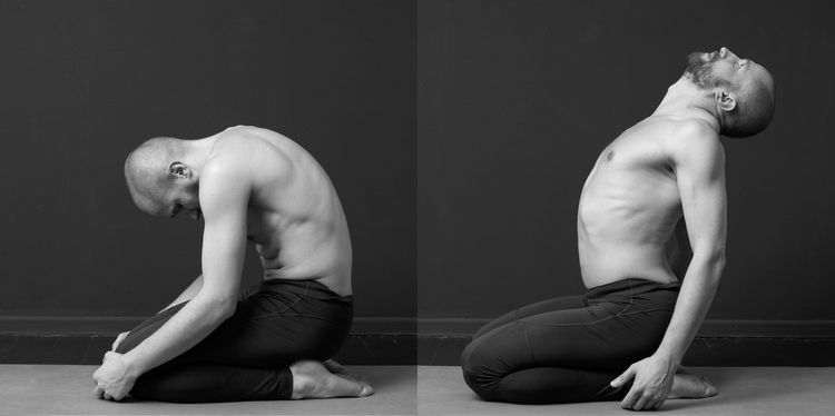 Photo of a young man with naked torso is doing exercises for the rib cage on the mat