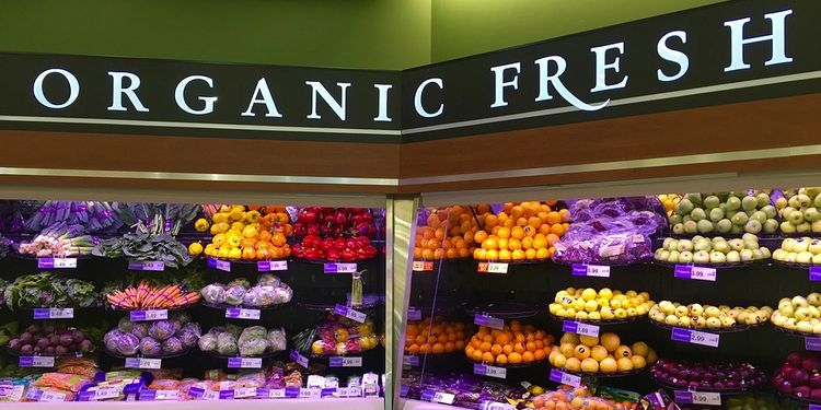 Photo of organic produce on shelves in market
