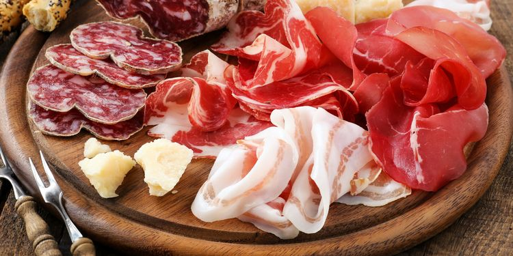 Photo of Italian salumi meat platter - prosciutto ham, bresaola, pancetta, salami and parmesan