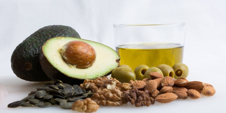 Photo of Healthy Food With Avocado, Nut, Olive Oil And Olive on white background