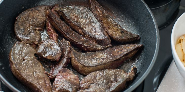 Photo of fried beef liver in a pan
