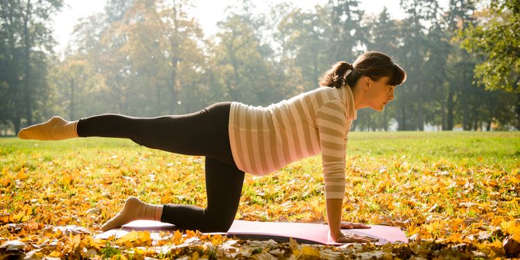 Photo of pregnant woman doing yoga