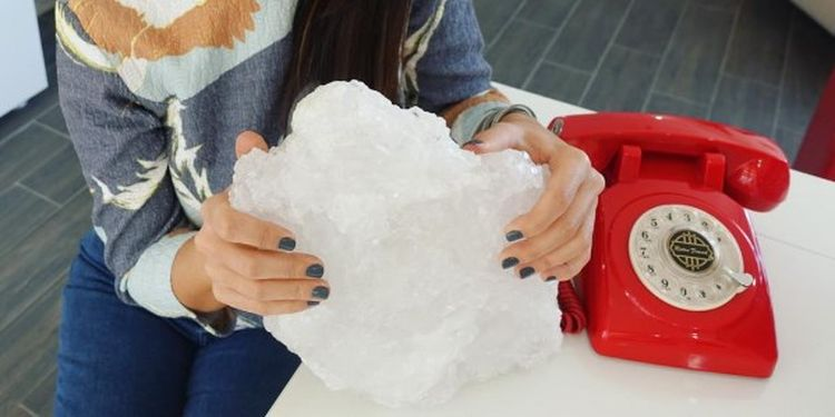 Image of a girl with a piece of sea salt