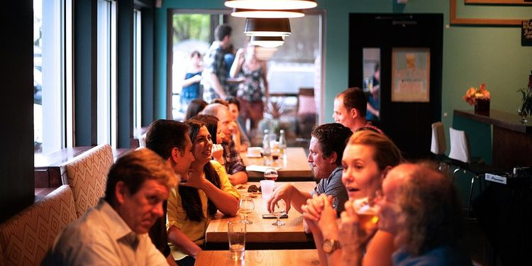 Photo of people socializing at a restaurant