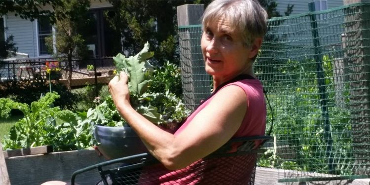Image of Terry Wahls with green leaves