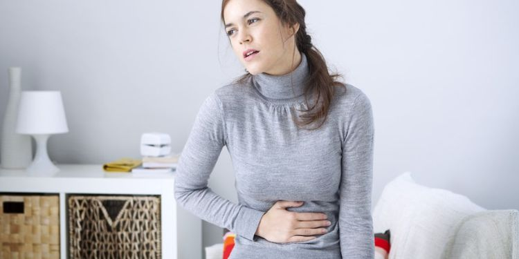 Image of woman suffering from Abdominal pain