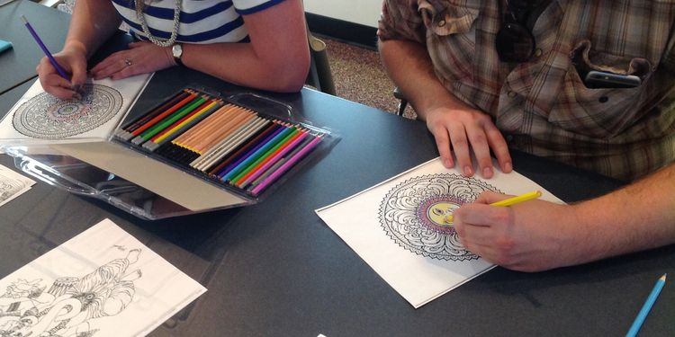 Photo of people coloring the coloring books