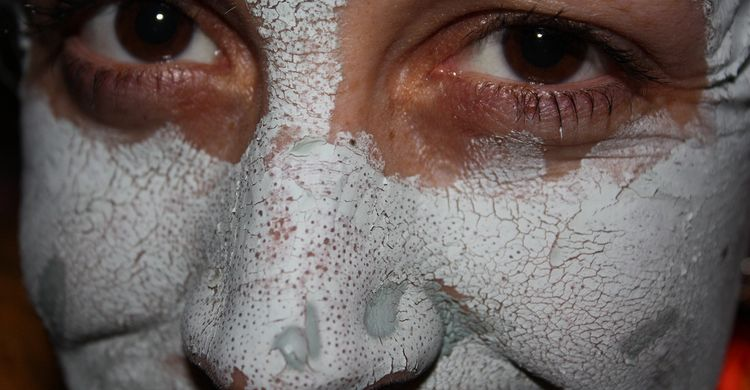 Photo close up of female face with bentonite clay mask