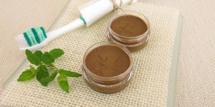 Photo of omemade toothpaste from coconut oil, healing clay powder and peppermint oil