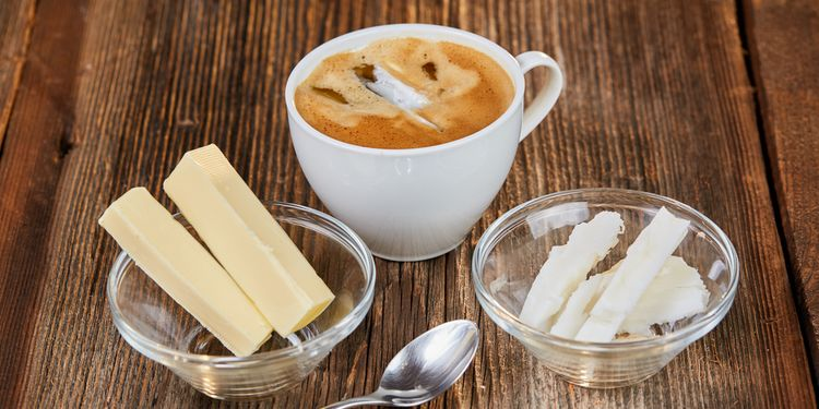 Photo of Coffee, butter and coconut oil for bulletproof coffee on a brown wooden table