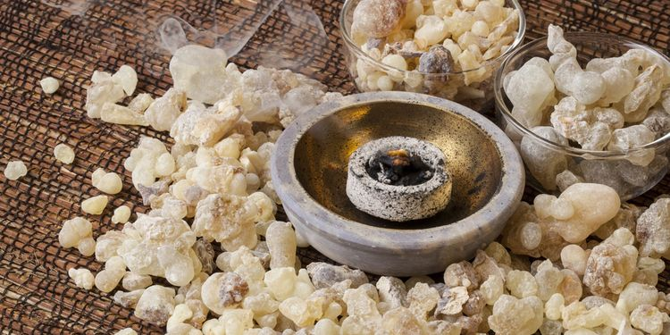 Photo of frankincense resin burning on a hot coal