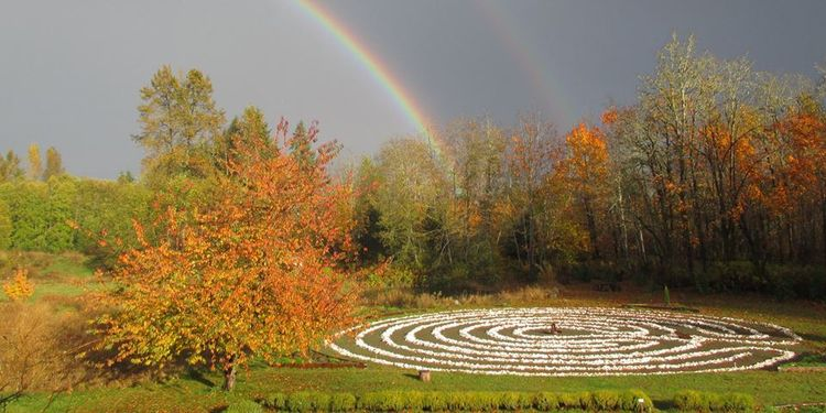 Photo of Innisfree Farm shell labyrinth with rainbow in background