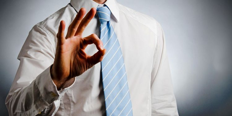 Photo of a man showing OK sign with fingers