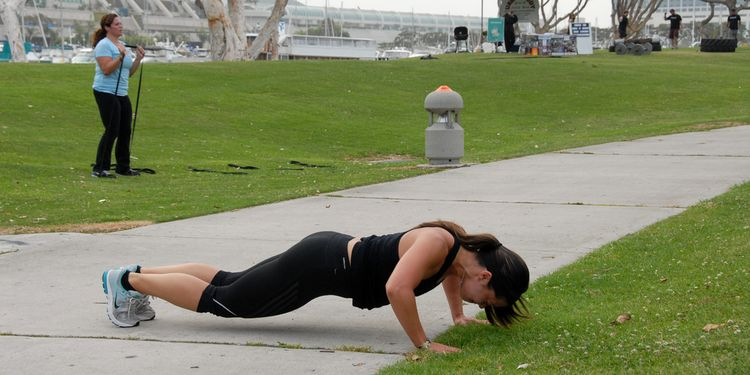 Photo of a women doing workout outdoors