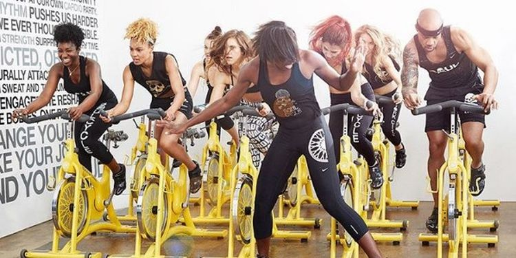 Image of women riding bikes at soulcycle