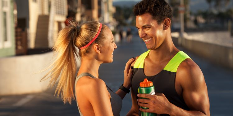 Photo of young fitness couple smiling