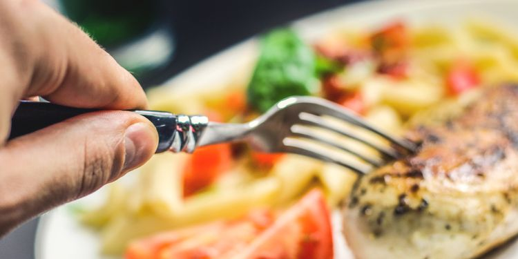 Photo of fork stabbing the food in the saucer
