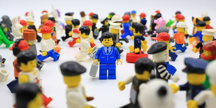 Photo showing lego figures representing lonely individual lost in busy crowd