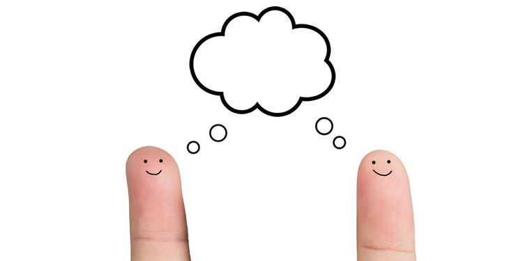 Photo of two fingers with drawn faces simulating conversation