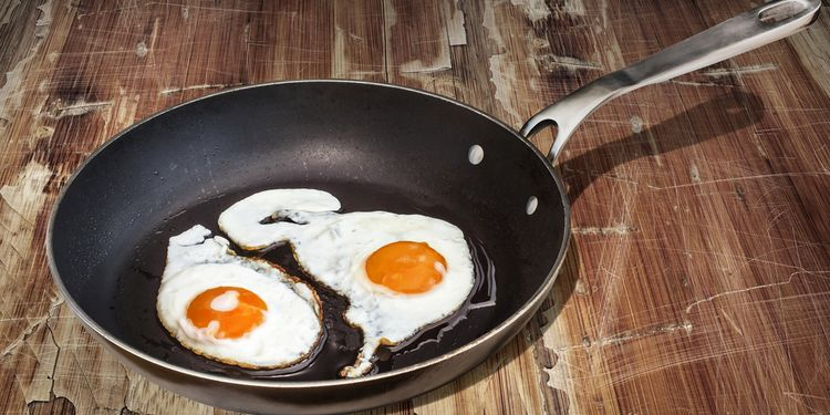 Photo of eggs frying in teflon pan