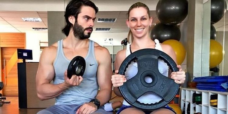 Image of a man and a woman in the gym