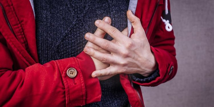 Image of a man feeling chest pain