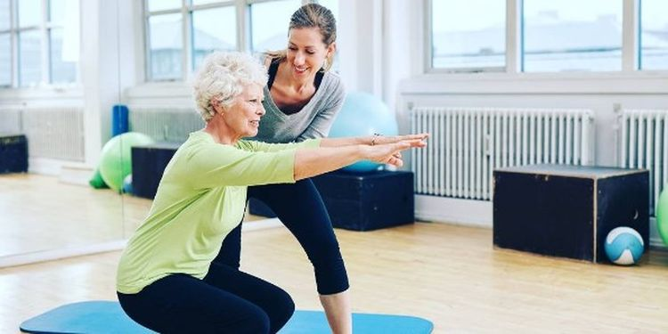 Image of an old woman doing exercises