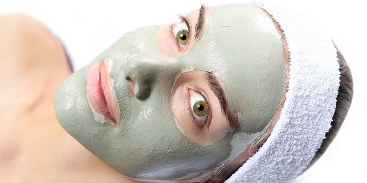 Photo of a woman with face mask for acne
