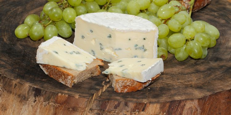 Photo of blue cheese slices on a plate