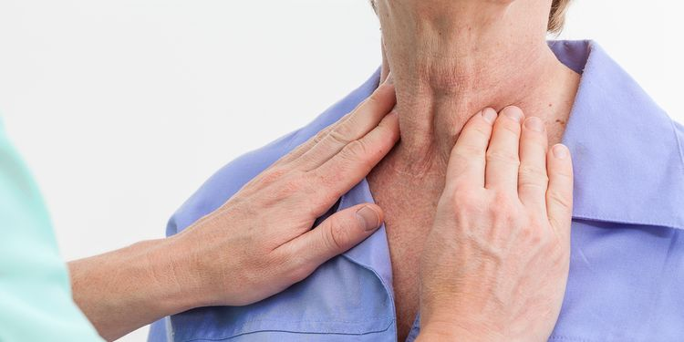 Photo showing thyroid gland examination by physician